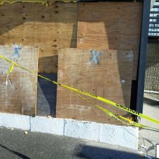 side of building boarded up due to collision damage business interruption in Providence, Rhode Island