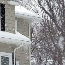 ice dam damage on roof in Cranston, Rhode Island