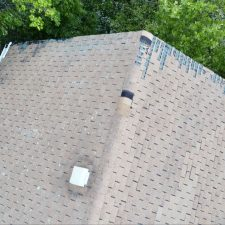 shingles missing from a storm caused roof damage in Providence, Rhode Island