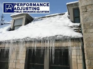 ice dam on a snow covered roof