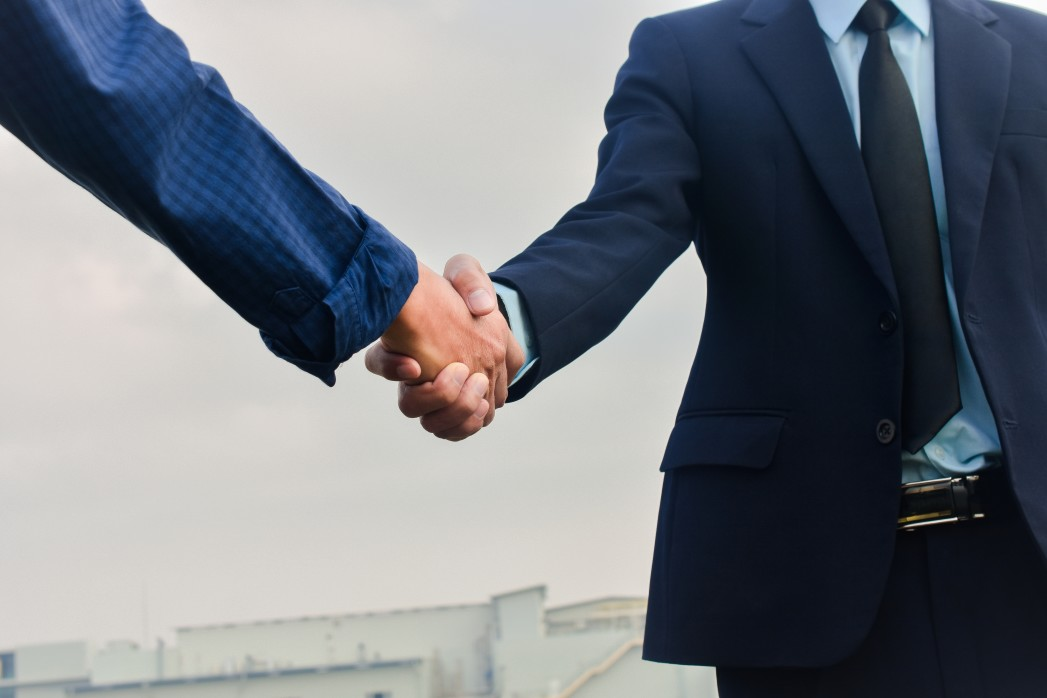 Business handshake with a public adjuster