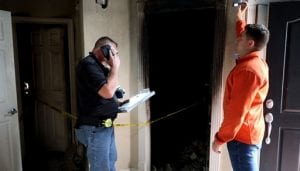 two public insurance adjusters estimating a fire damage claim